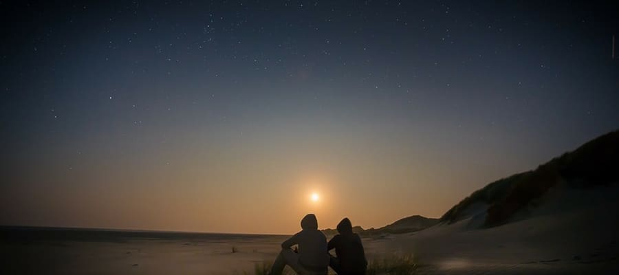 Two people stargazing