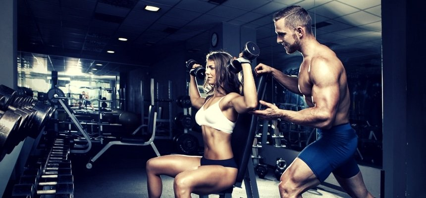 Attractive couple at gym working out
