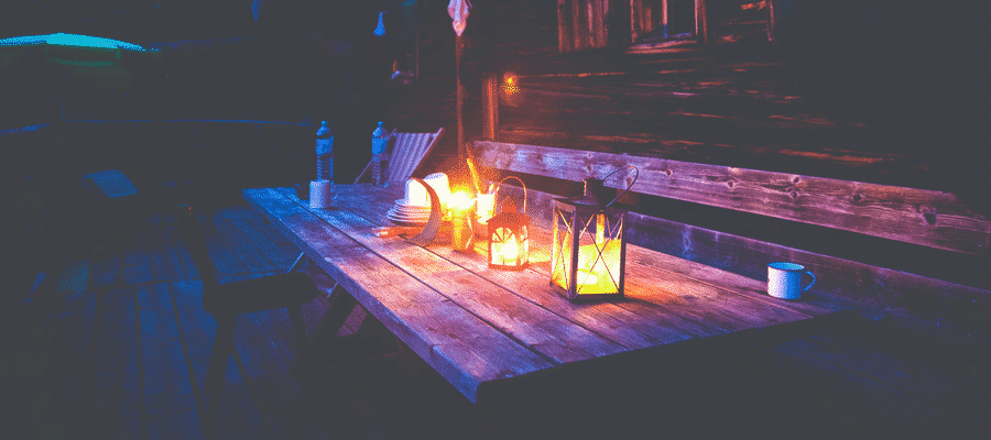 Outdoor candles and table at night