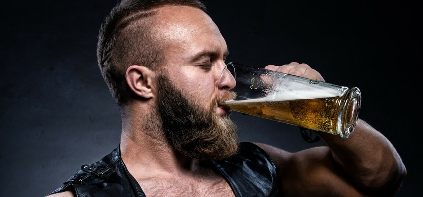 Bearded manly man drinking beer