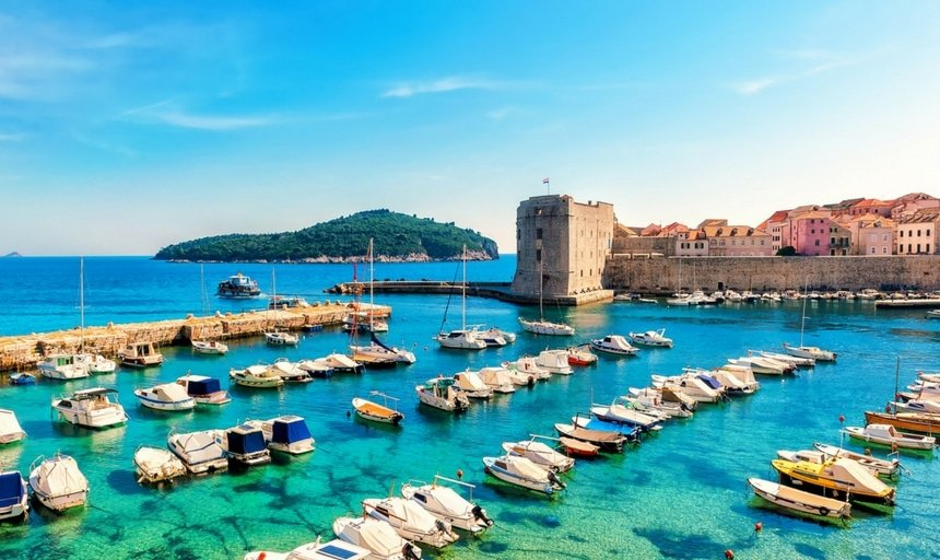 Beautiful sunny day over the bay in front of old town of Dubrovnik, Croatia with boats