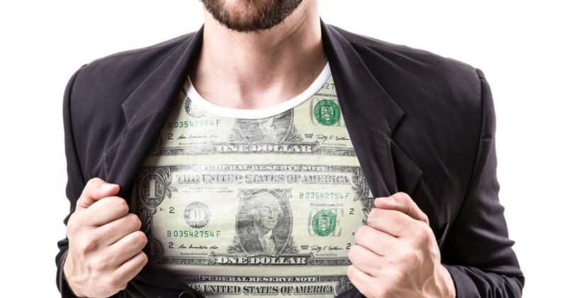Man in shirt with dollar bill on it and jacket