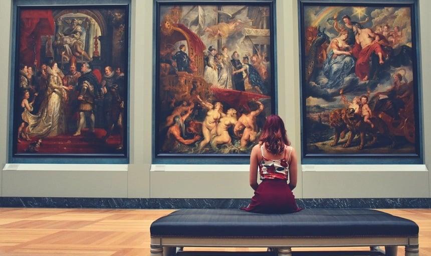 Girl sitting down admiring classical art