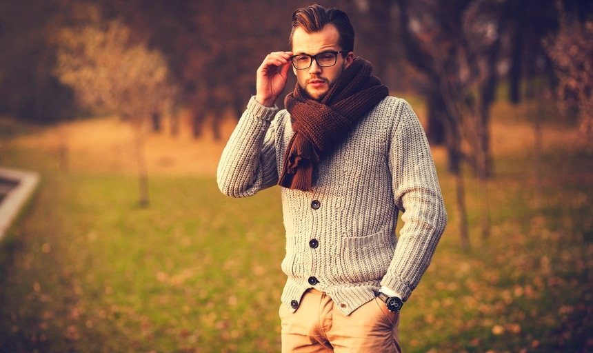 Man in glasses with cardigan and scarf outside