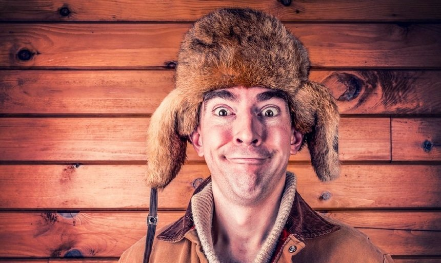 Man in winter hat making silly face