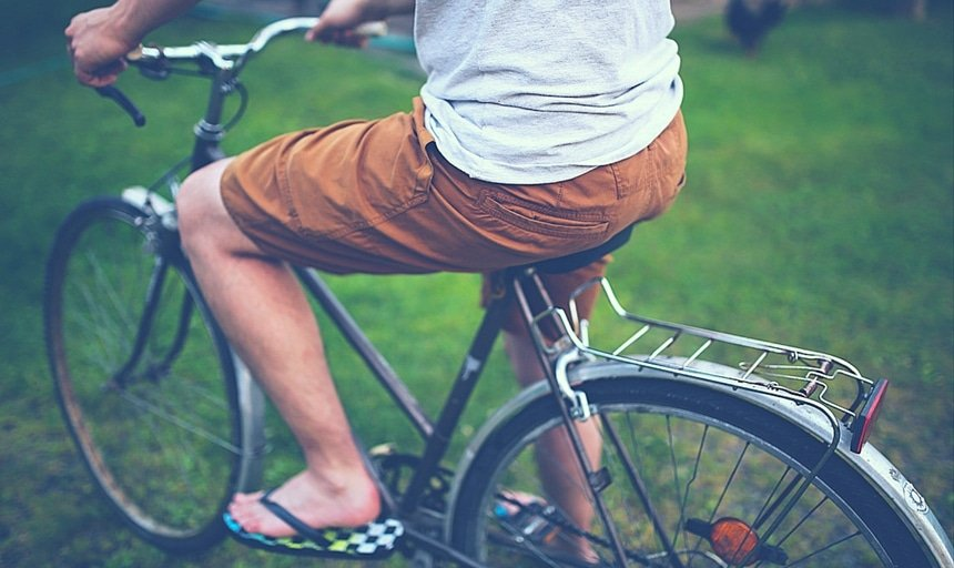 Man riding bike with brown shorts