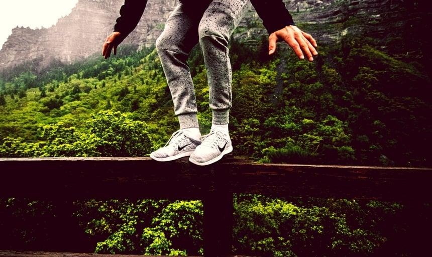 Man sneakers balancing on rail