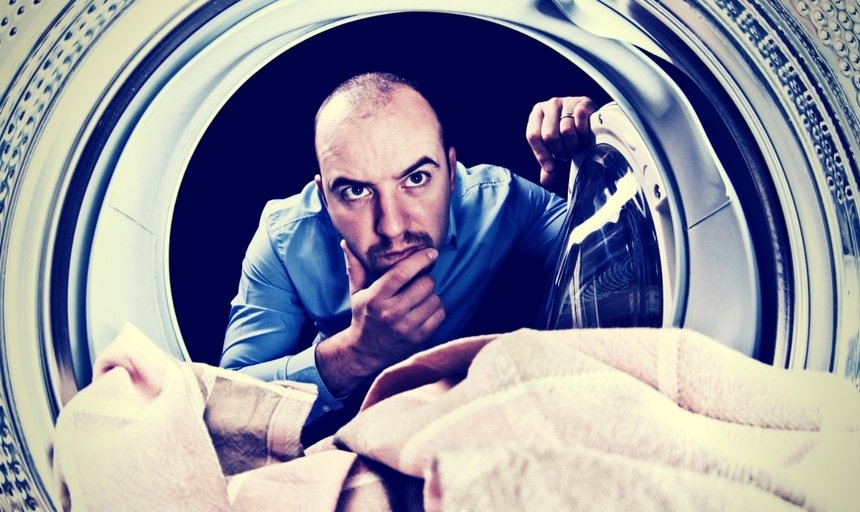 Man with head in dryer trying to figure out how it works