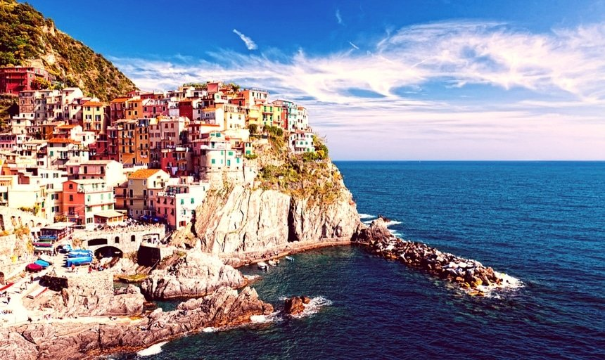 Manarola village on cliff rocks and sea at sunset., Seascape in Five lands, Cinque Terre National Park, Liguria Italy Europe