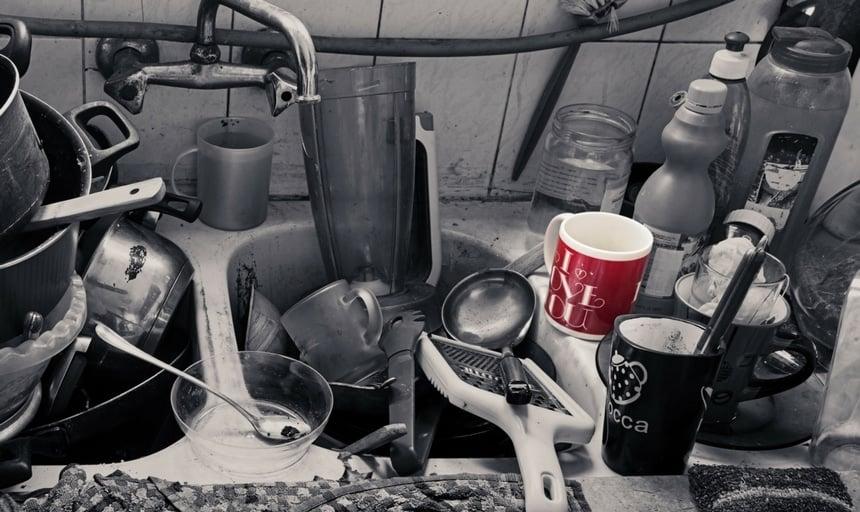Messy kitchen with I Love You Mug