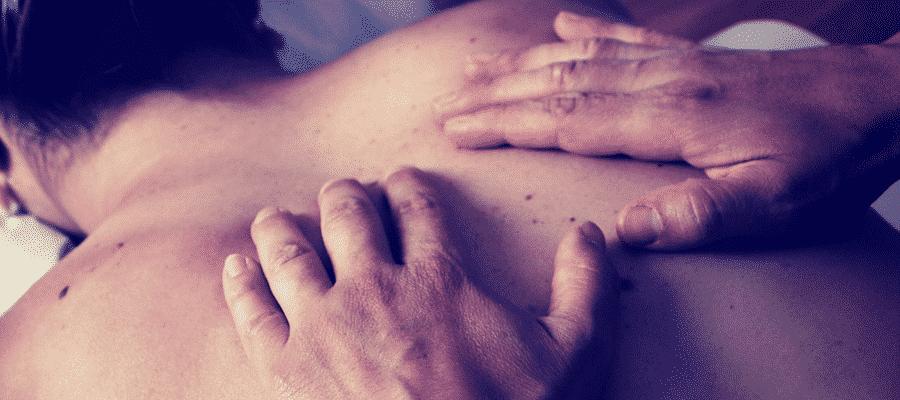 Man massaging a woman