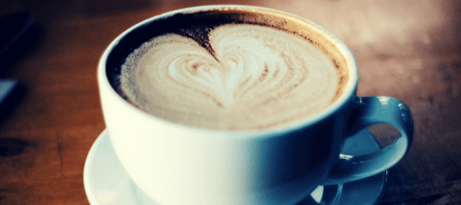 Coffee cappuccino with a heart shaped froth