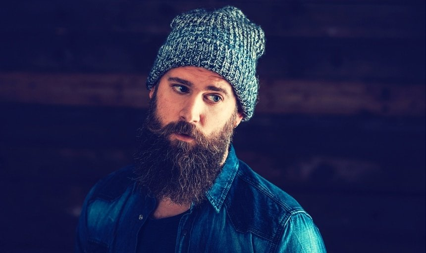 Stylish man with beard and beanie and denim jacket