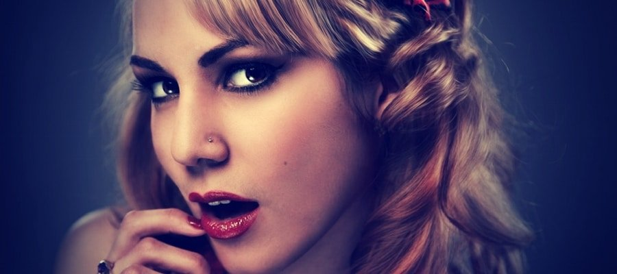 Attractive blonde girl with nose ring and red lipstick