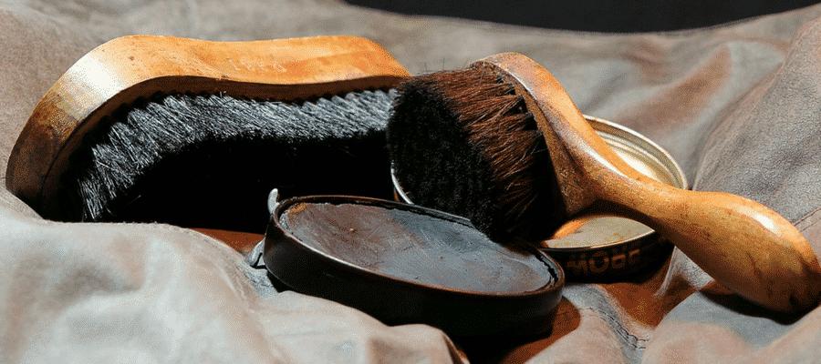 Black shoe polish with brushes