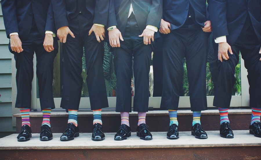 Group of men with colorful socks