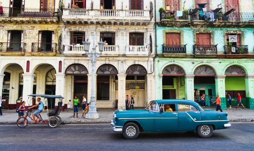 Streets of Havana, Cuba, blue car and bike
