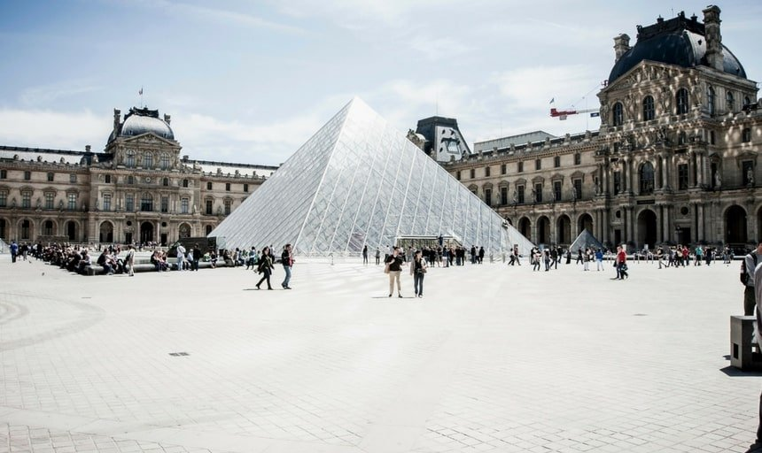 The Louvre, Paris, France. Crowds walking outside