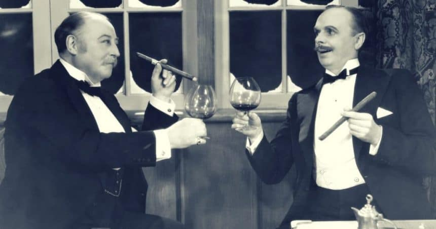 Two men drinking wine and smoking cigars vintage bromance