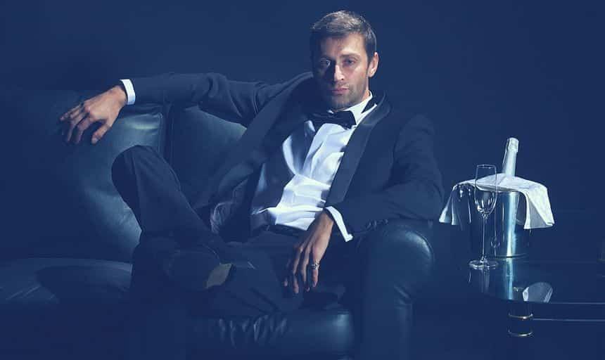 Attractive man in tuxedo sitting down