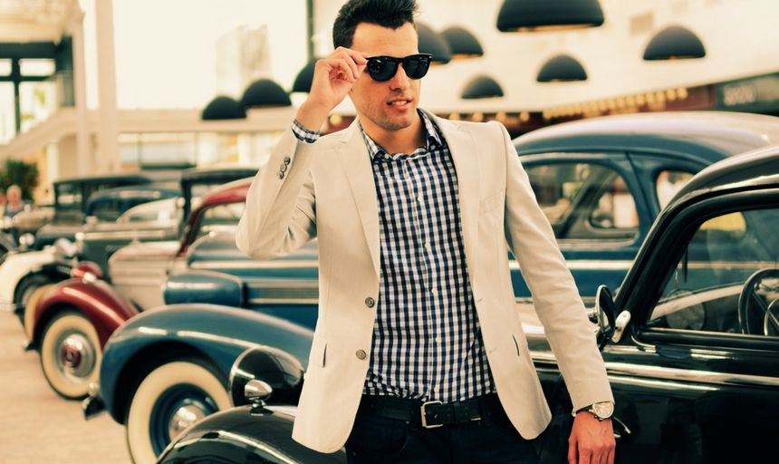 Attractive man with sunglasses and white coat