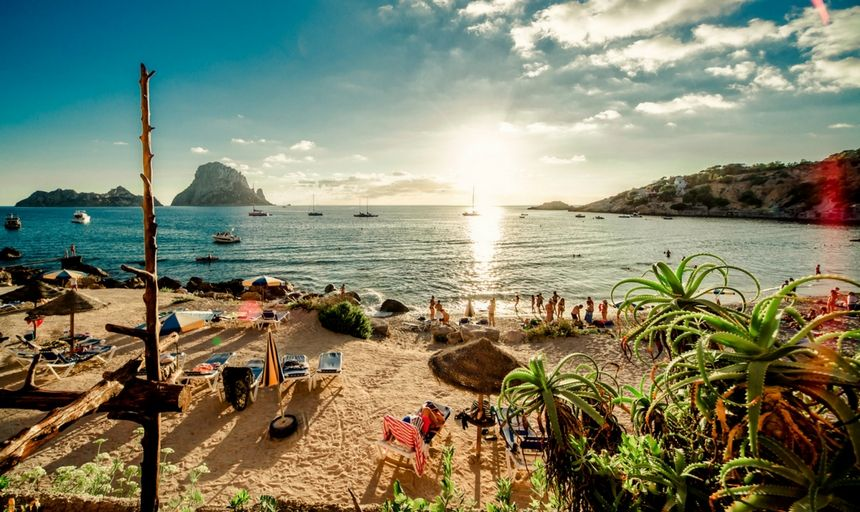 Ibiza at sunset, people on the beach