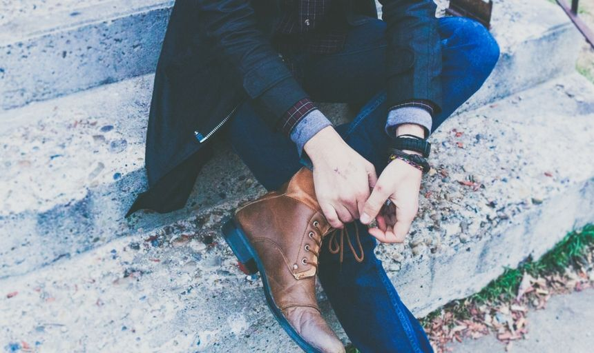 Man sitting in denim and boots