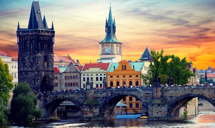 Tyn Church in Prague at sunset with bridge