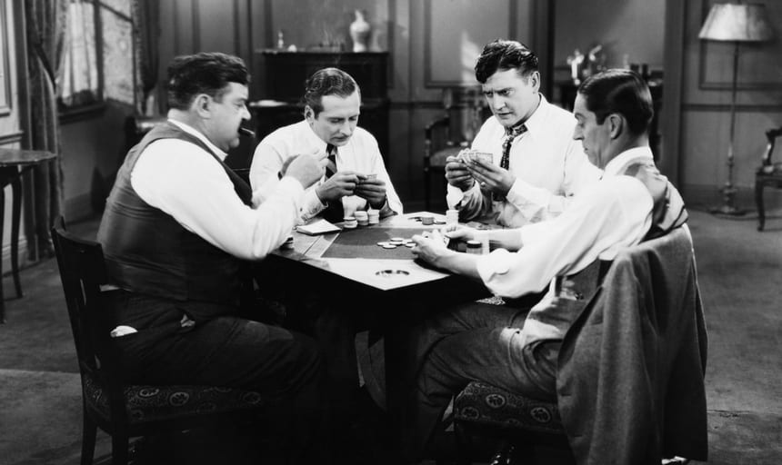Four business men playing poker - vintage black and white