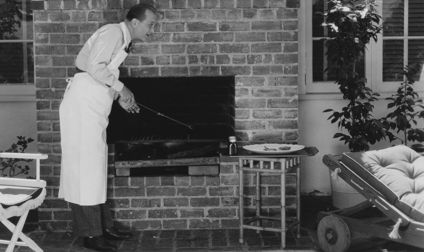 Man barbecueing outside - black and white vintage style