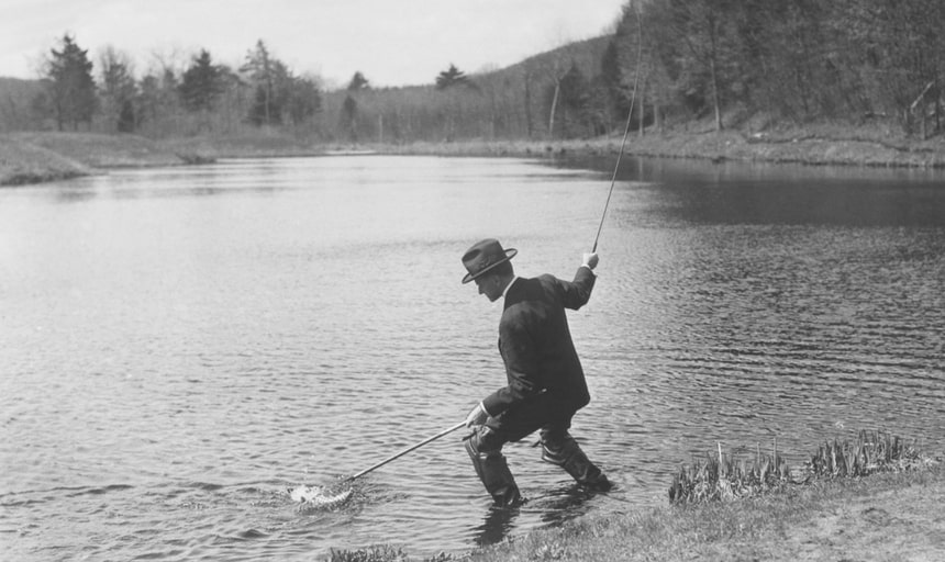 Man fishing with a net and rod - black and white vintage