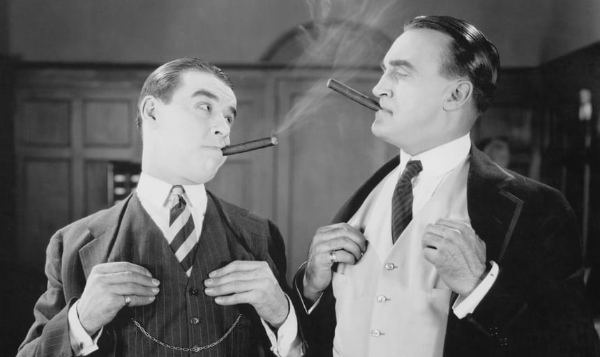 Two business men smoking cigars vintage black and white style