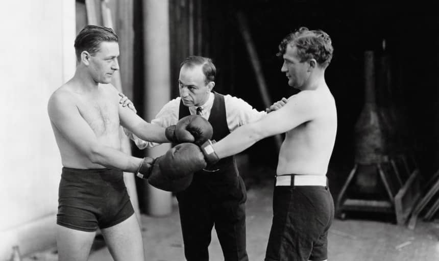 Two men boxing with referee about to start the fight - vintage black and white