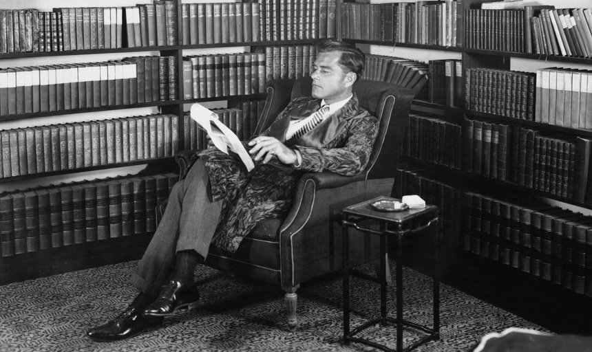 Vintage image of a man reading in his library study - black and white