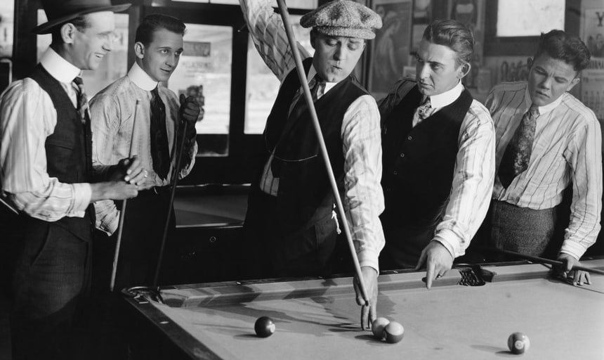 Vintage men playing pool, playing a tough shot