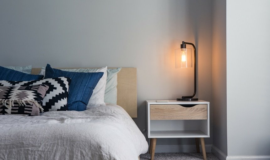 Bed with lamp on next to it