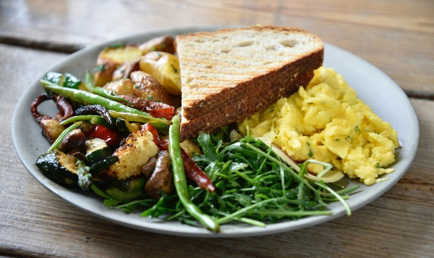 Healthy meal of toast, eggs, vegetables, and salad