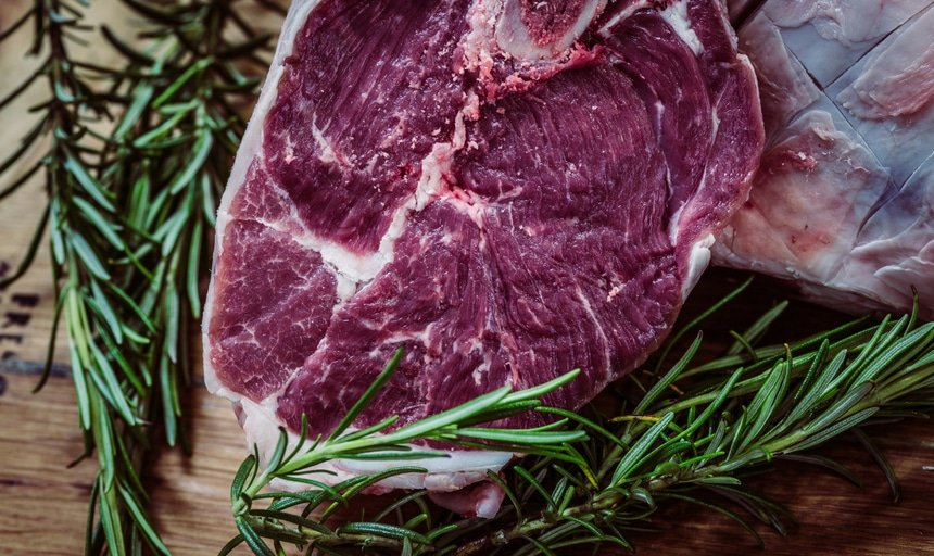 Steak with herbs in background