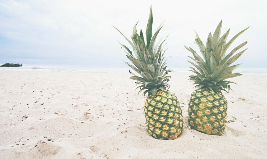 Two pineapples on the beahc