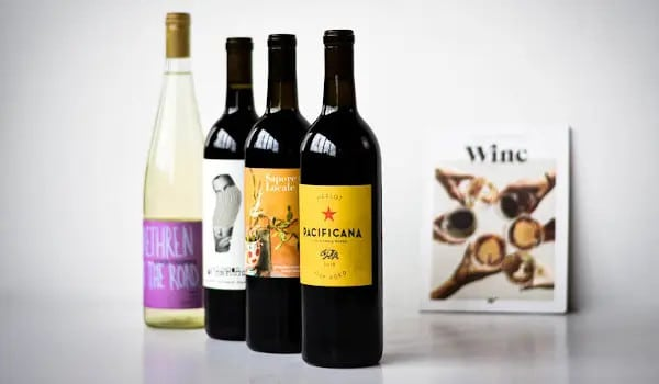 Winc Wine Unboxing Image of Four Wines and Leaflet
