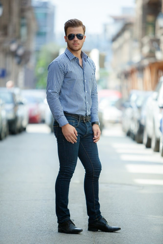 Business casual with jeans male model wearing business shirt tucked in