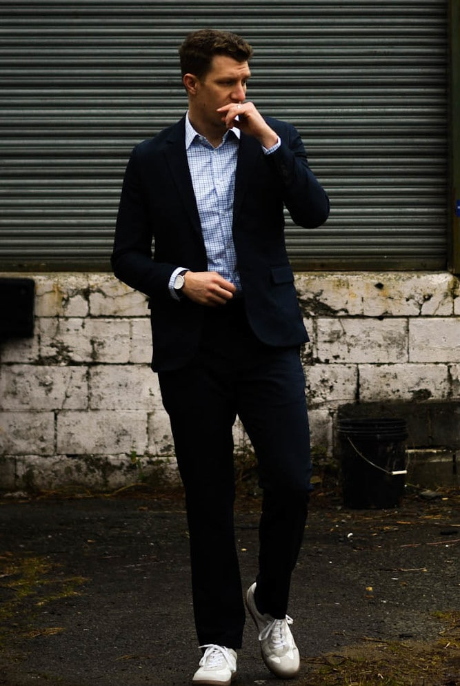 Model Wearing Bluffworks suit and business casual with white sneakers