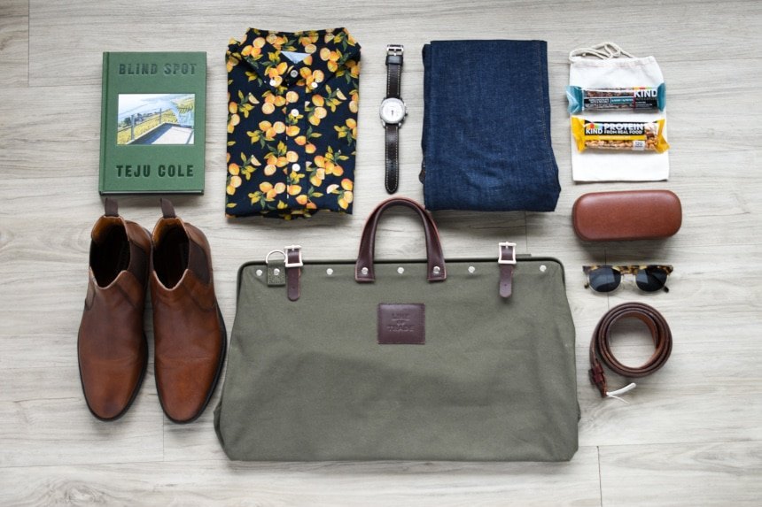 Top Down of Bespoke Post Weekender Bag and Other Unrelated Men's Accessories
