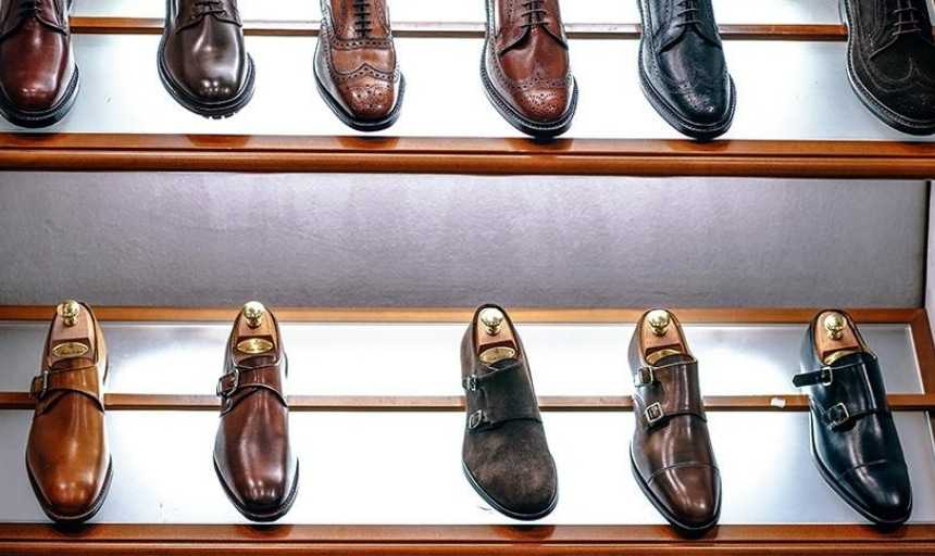Rows of leather dress shoes in a store