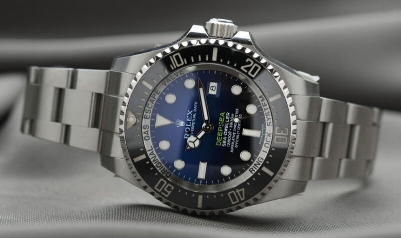 Best Online Watch Stores_ Picture of a Rolex Lying On Its Side With A Gray Background