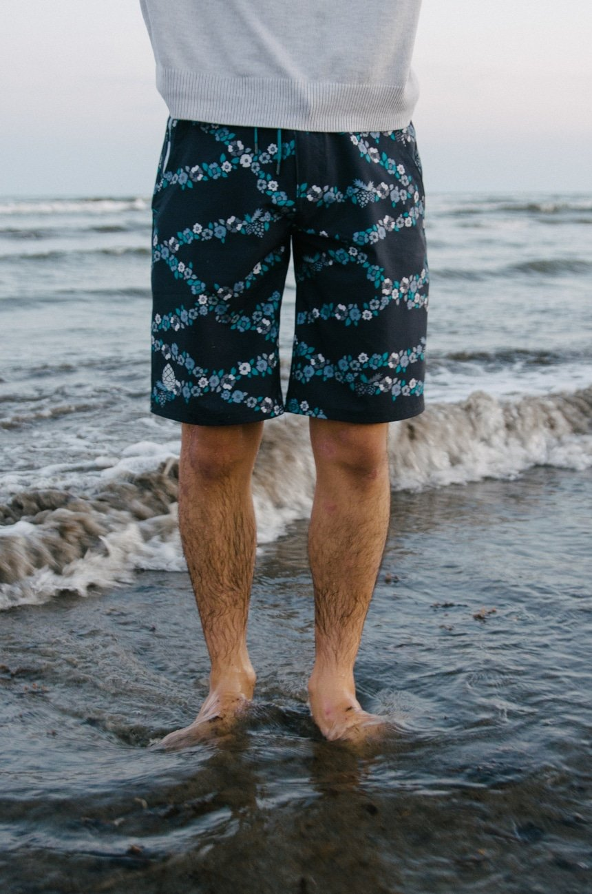 Model Wearing Stio CFS Board Short Close Up on Legs In The Water At The Beach