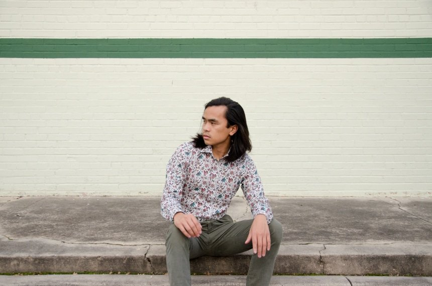 Model Wearing Apposta 100% Pure Cotton Poplin Floral And Sitting On Street Landscape