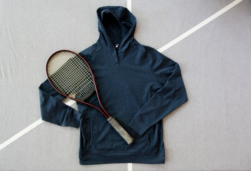 Product Shot of Public Rec Politan Hoodie With A Tennis Racquet