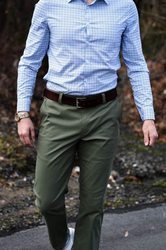 model walking wearing wooden watch green chino and blue checked dress shirt