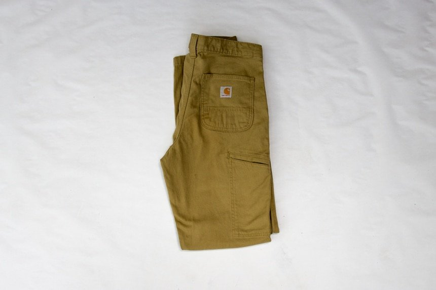 Carhartt Rugged Flex Rigby Dungaree folded back facing with pocket on white background